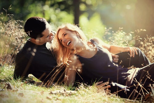 couple laughing on grass bond