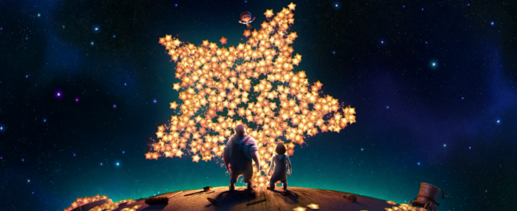 man and boy with giant star