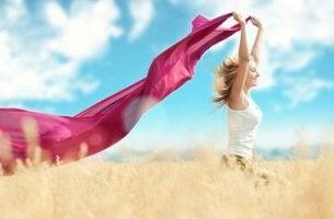 Happy Woman Running in Field