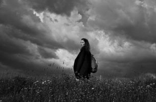 Woman in Cloudy Field