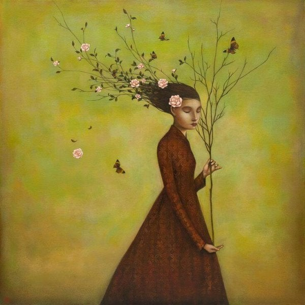 woman holding a branch
