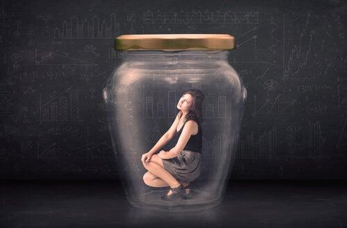 woman trapped in a jar afraid