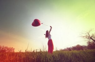 woman with heart balloon