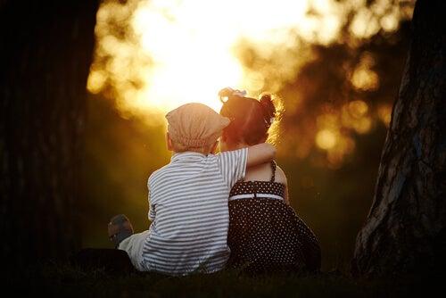 Boy Hugging Girl at Sunset