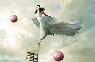 woman balancing blindfolded deception