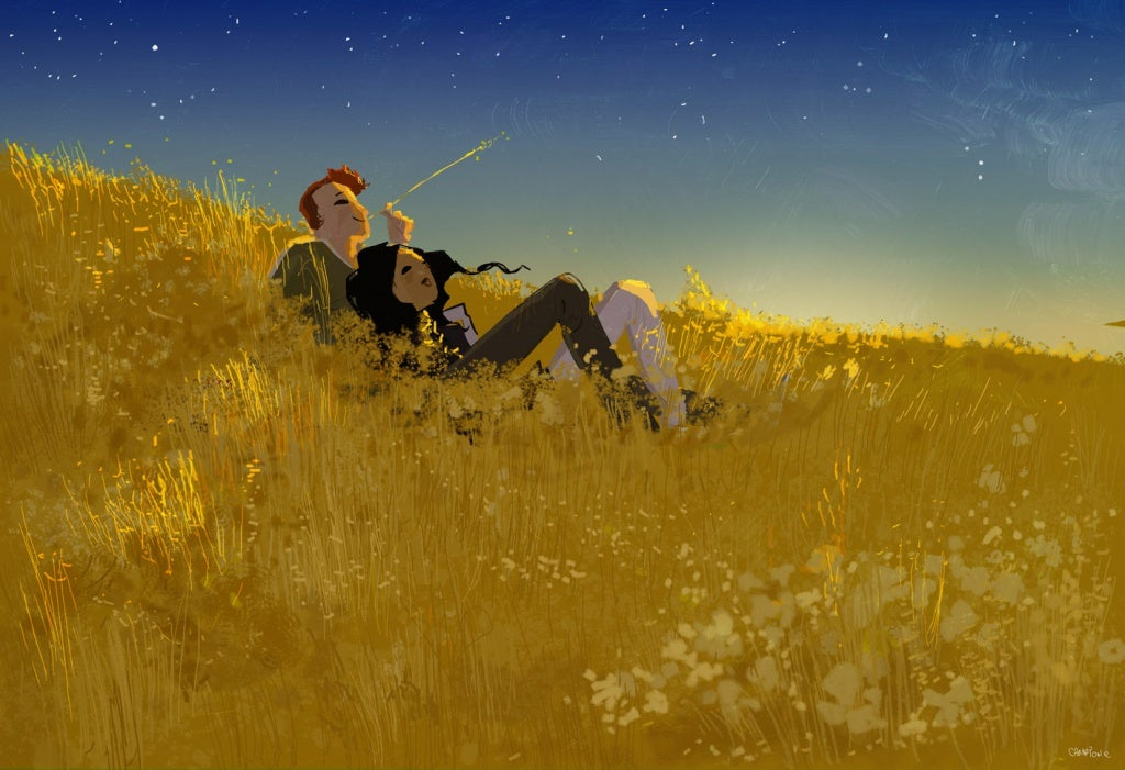 couple lying in a field looking at stars