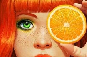 girl with orange slice covering eye