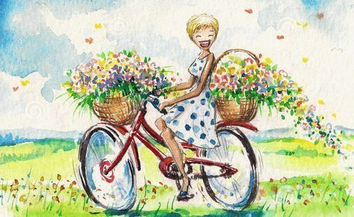 happy girl with flowers on bike