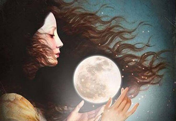 Nainen pitelee kuuta käsissään