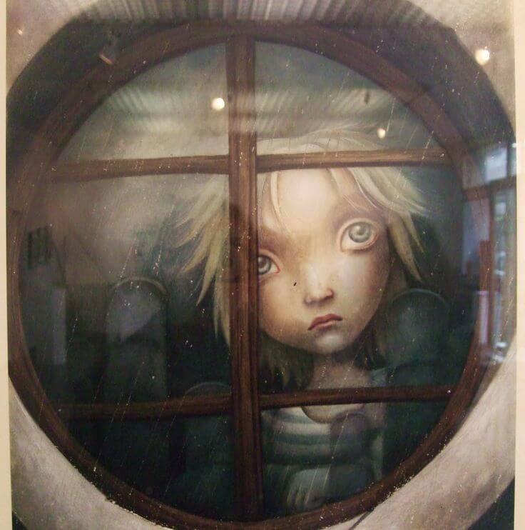 sad boy behind a window