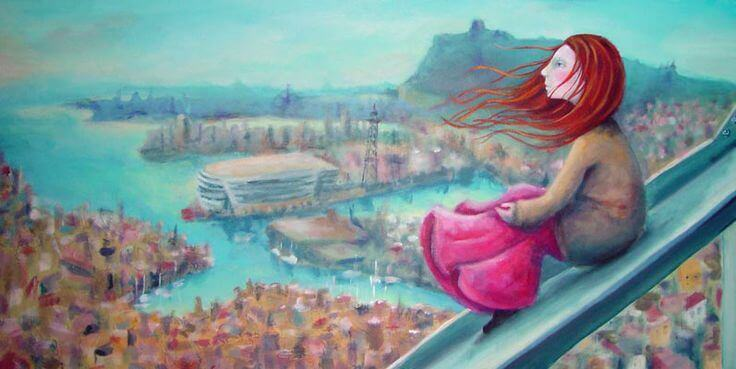 girl looking over city dreaming