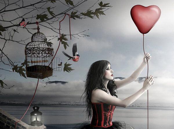 woman holding a heart-shaped balloon