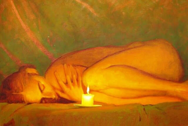woman laying in front of a candle