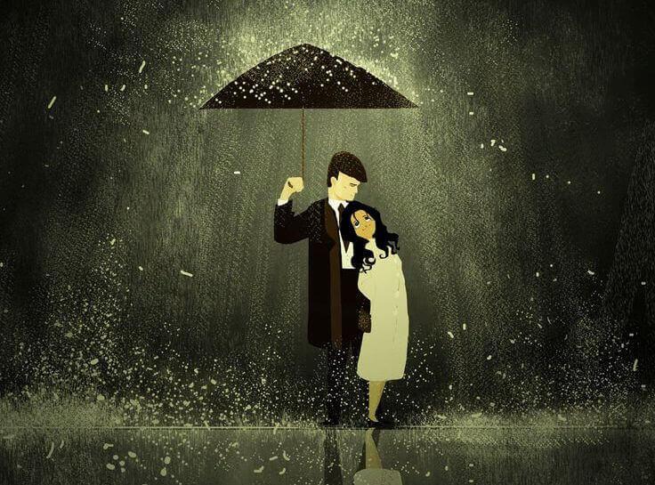 Pari suojautuu sateelta