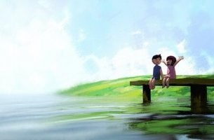 boy and girl sitting on a dock