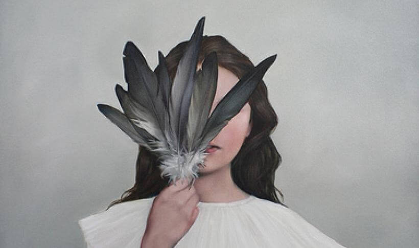 Girl Hiding Face with Feathers