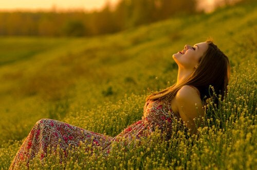 happy woman in meadow