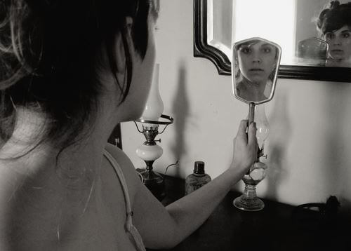 lady looking in a mirror