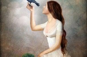 lady white dress holding bird