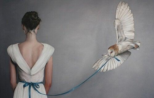 Owl Pulling Girl's Ribbon