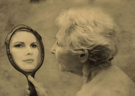 old woman looking in the mirror