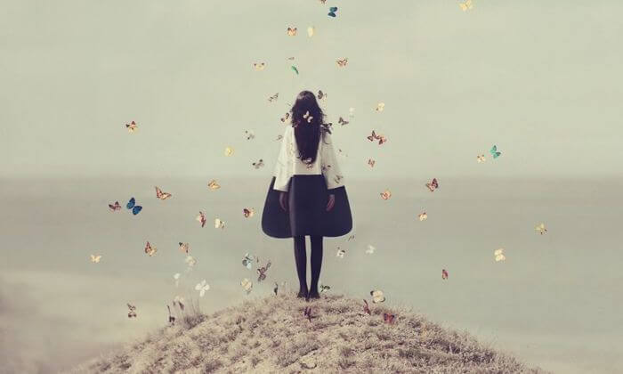 young girl surrounded by butterflies