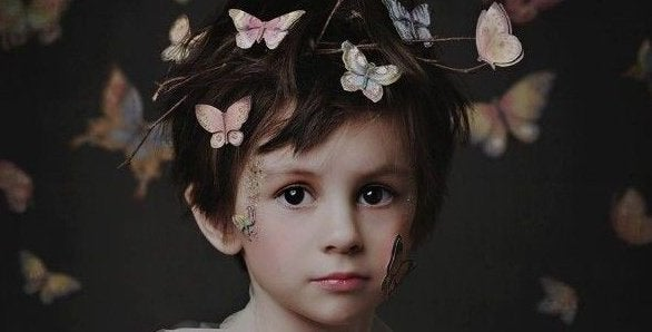 boy with butterflies on his head-e1456699760764