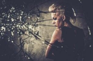woman behind broken window fears