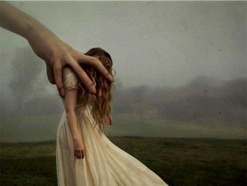 giant hand grabbing girl