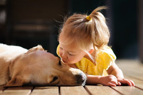 girl blowing a dog a kiss