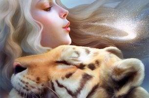 girl holding tiger