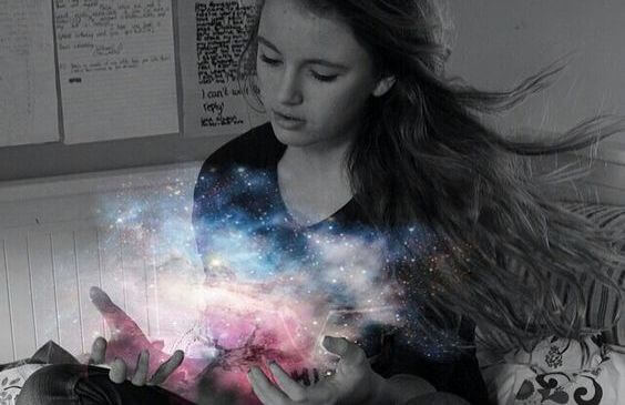 girl with the light of the universe in her hands