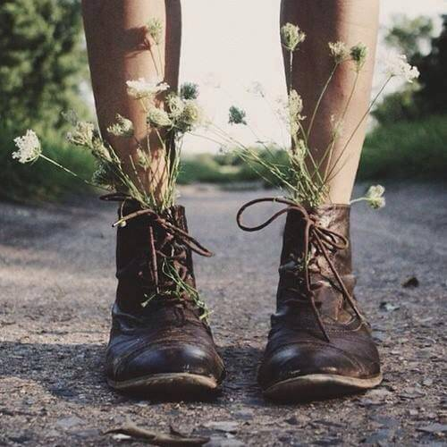 legs with boots filled with flowers