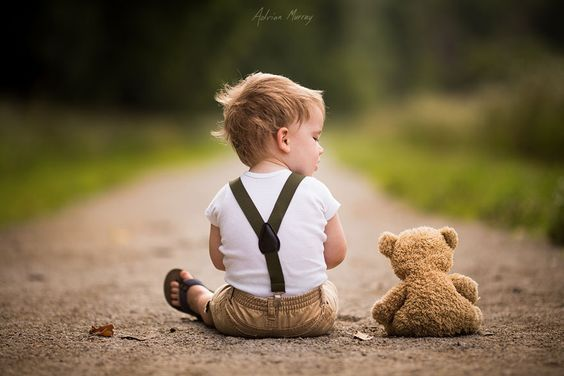 little boy and stuffed bear