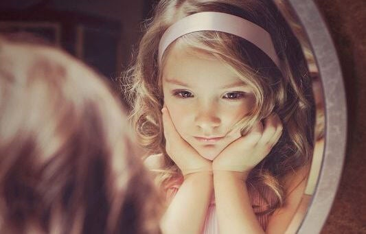 little girl in mirror