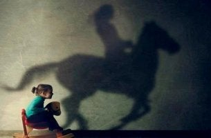 Girl on Wooden Horse, Shadow of Real Horse