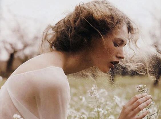 woman amongst white flowers