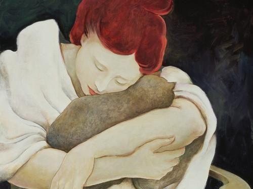 woman hugging a cat