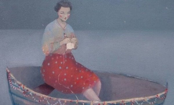 woman knitting on a boat