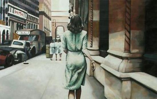 woman with her back turned in a green dress
