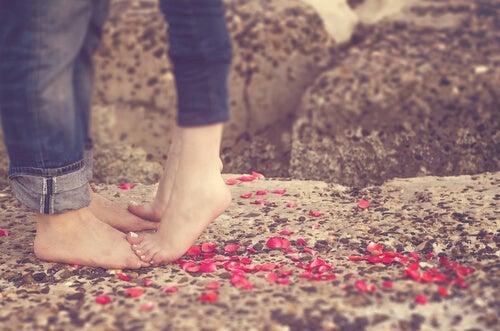 woman's feet on top of man's feet