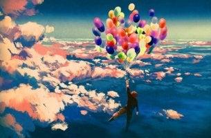 man flying balloons