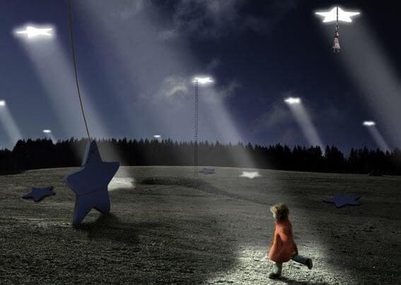 girl walking towards giant stars