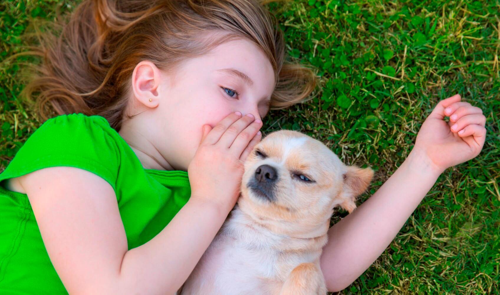 girl whispering in dogs ear