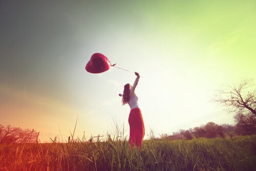 girl with balloon in field