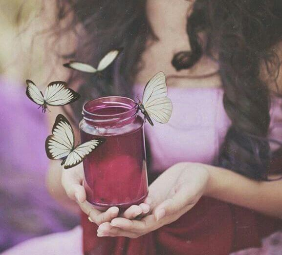 girl with jar and butterflies