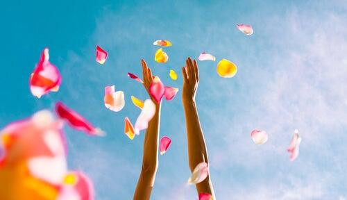 hands throwing flower petals