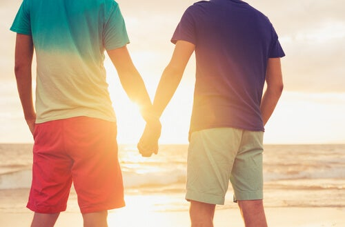 male couple holding hands