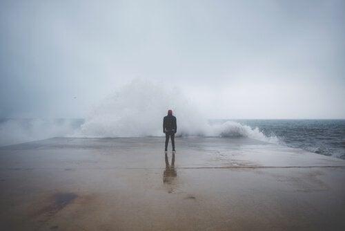 man in front of sea feeling fear