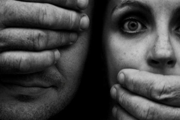 man silencing woman
